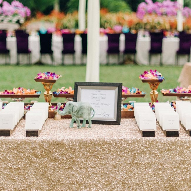 Glittery linens topped the escort card table, where guests found their table assignments on formal cards placed into rows.