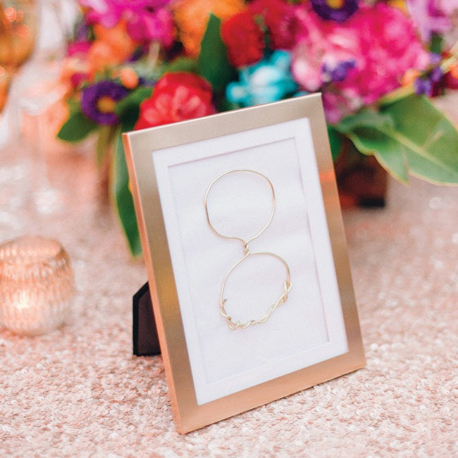 Gold wire was twisted into numbers for unexpected, yet elegant, framed table numbers.