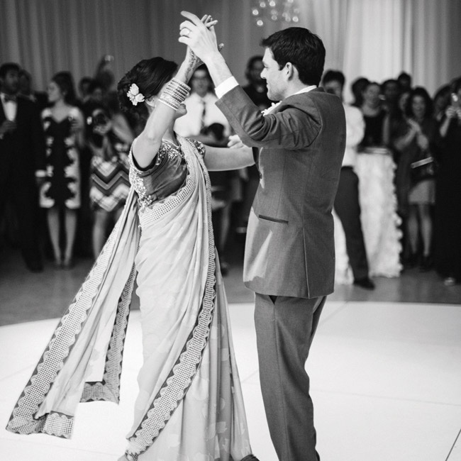 "For the reception, Indhu traded in her bridal gown for a traditional Indian sari. They had their first dance to ""Ain't It Enough"" by Old Crow Medicine Show. ""We whole-heartedly identify with the lyrics and want to remember them forever,"" Indhu says."