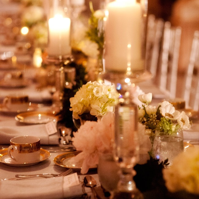 Long floral garlands, dotted with numerous white candles, lined the center of the tables at the reception.