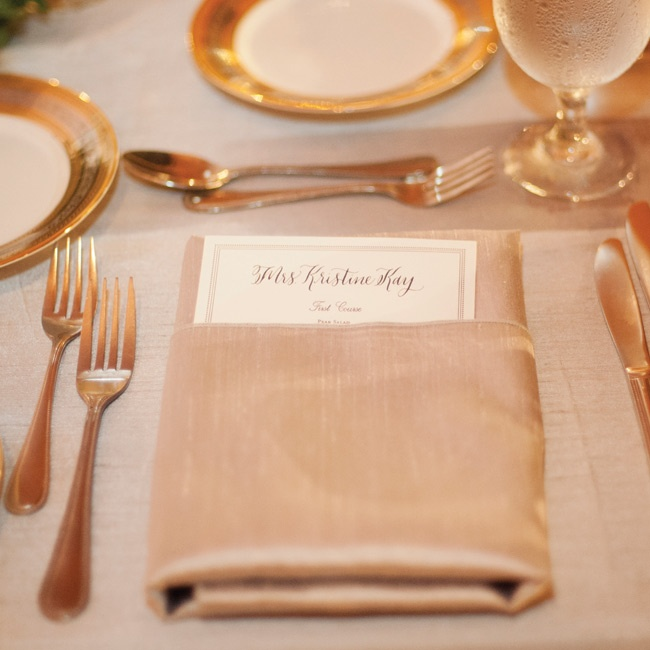 Gold accents popped up throughout the decor, including the place settings and the ink on the custom menu cards.