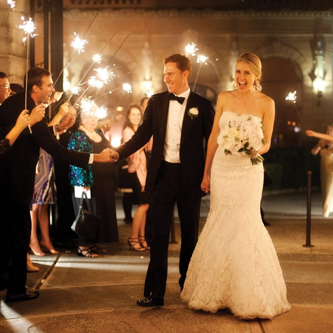 At the end of the celebration, Lauren and Adam exited through a tunnel of sparklers to a waiting Rolls-Royce.