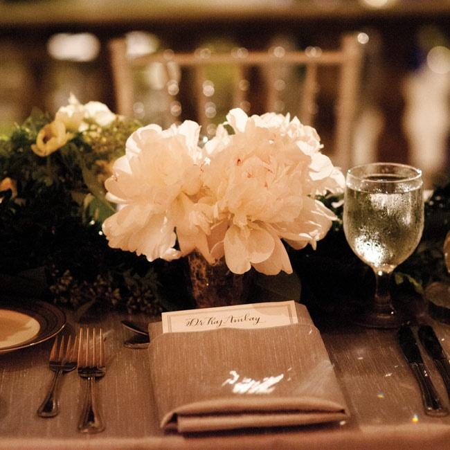 Lush white peonies (one of Lauren's favorite flowers) were used in both her bouquet and the centerpieces.
