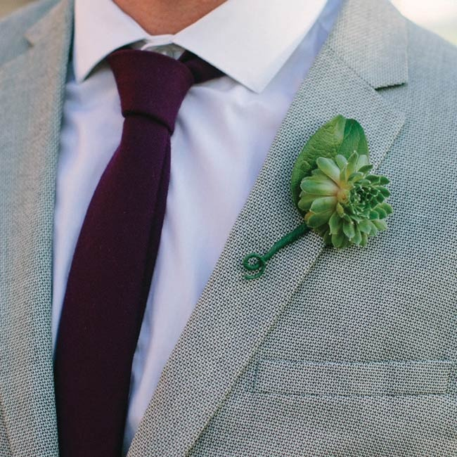 "Graeme's four groomsmen wore succulent boutonnieres on the lapels of their gray suits. ""We asked them to wear gray with white shirts and jewel-tone ties,"" recalls Molly. ""They looked great!"""