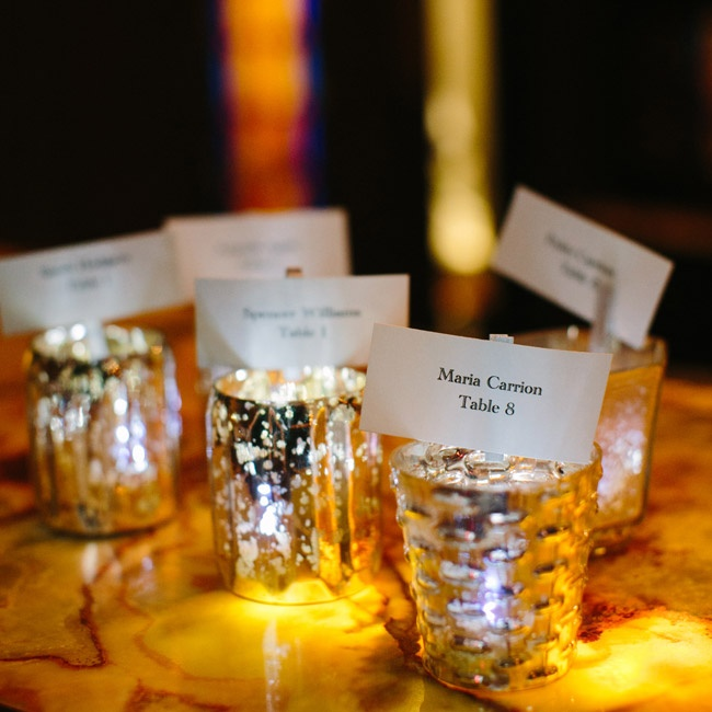 Guests found their escort cards in mercury glass votives, which also doubled as favors.