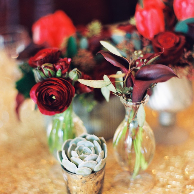 Groupings of small vases filled with succulents, ranunculuses and calla lilies gave the guest tables romantic flair.