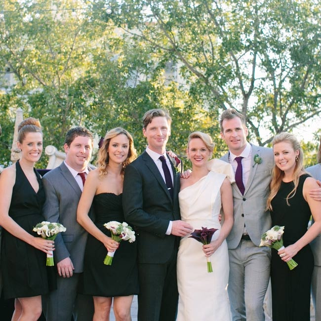 "Molly's bridesmaids chose their own black dresses for the celebration. ""They are all different and each have a distinct sense of style, so never in a million years would I have wanted them to wear the same dress,"" she says. The groomsmen wore gray suits with jewel-tone ties."