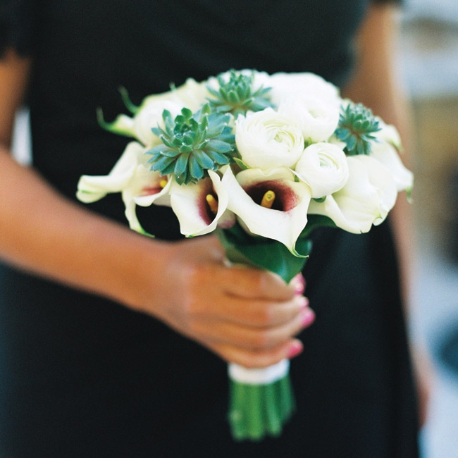 The bridesmaids carried small bouquets of white calla lilies, ranunculus and succulents.