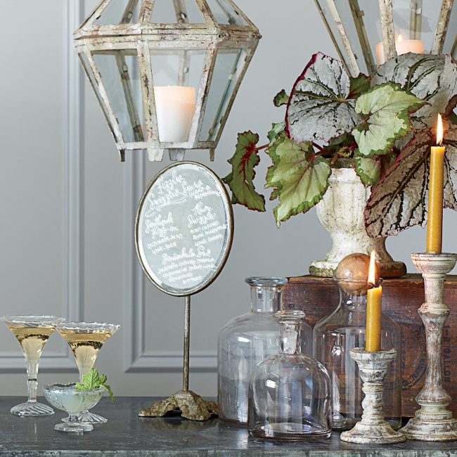 Make a style statement at the bar by with an eclectic display of old, unpolished metals; weathered accents; reclaimed wood with lush greenery; and new, elegant glass details.