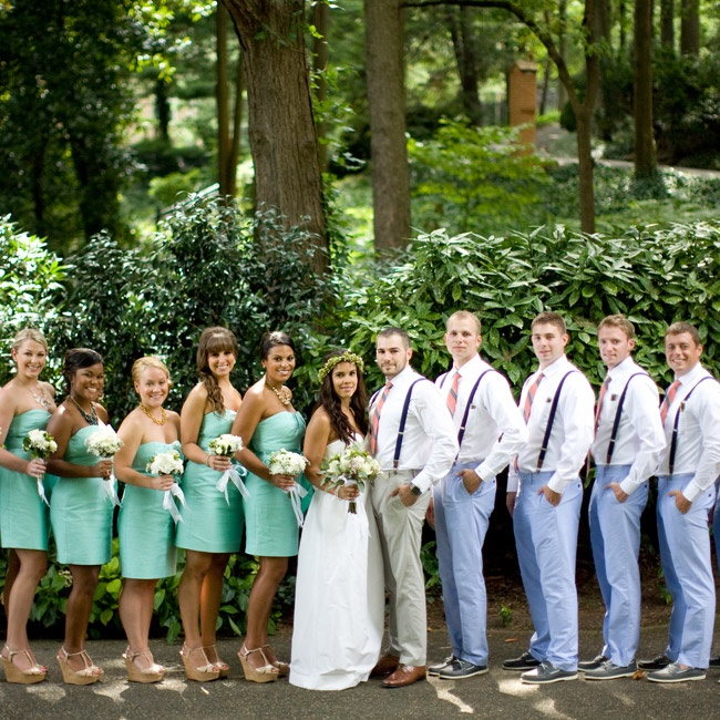 The bridesmaids wore similar bright teal dresses from J.Crew. They paired the dresses with statement necklaces and matching wedges.