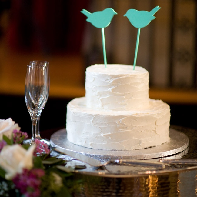 The bride's father painted the bird-shaped cake toppers in a color that complemented the rest of their bright wedding.