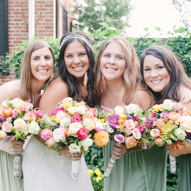 The bride and her bridesmaids all wore natural makeup and loose hair to maintain an ethereal, laid-back vibe. For her own hair, Erin created a one-of-a-kind headpiece by stringing beads, crystals and pearls on a long wire, which her stylist incorporated into her curls.