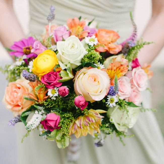 The three bridesmaids carried bouquets that were designed to mirror the bride's colorful arrangement.