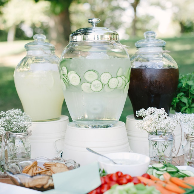 At the cocktail hour, guests enjoyed refreshing drinks and small bites, including veggies and dip, artisanal cheeses, corn fritters, mini BLTs, spicy shrimp and a fresh oyster bar.