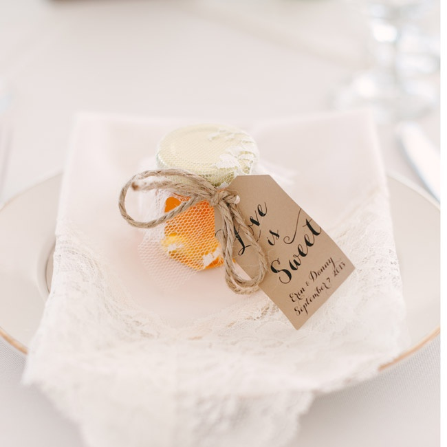 "Guests received small jars of local honey decorated with a ""Love Is Sweet"" tag. ""The cute jars of honey added to our table decor, and we also personally use local honey frequently in cooking,"" Erin says."