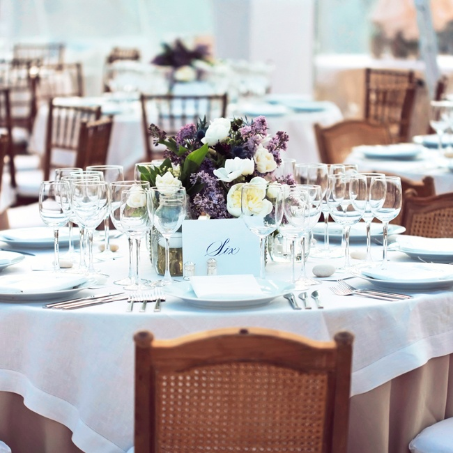 Low centerpieces of loosely arranged white, green and soft lavender florals in mason jars sat on the tables.