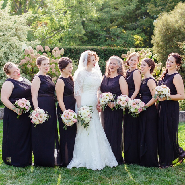 Aiming for a dress that all her attendants would love, the bride selected a floor-length black gown with a bateau neckline for the bridesmaids.