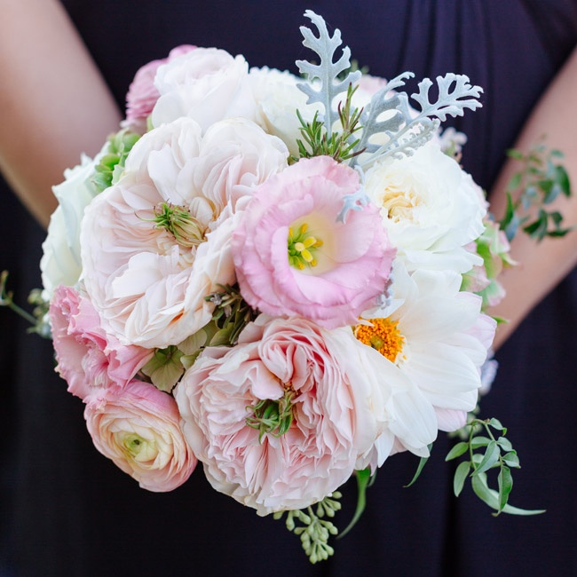 The bridesmaid bouquets were designed to complement the bride's flowers. The arrangements included pink peonies, camellia, cosmos and ranunculuses.