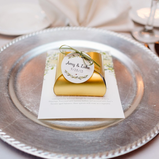 Gold favor boxes—filled with homemade truffles in a variety of flavors—sat atop the menu card and a sliver charger.