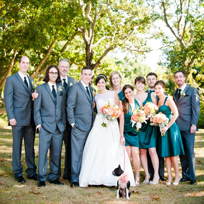 The groomsmen all wore matching charcoal gray suits, while the bridesmaids wore knee-length teal dresses in their choice of styles.