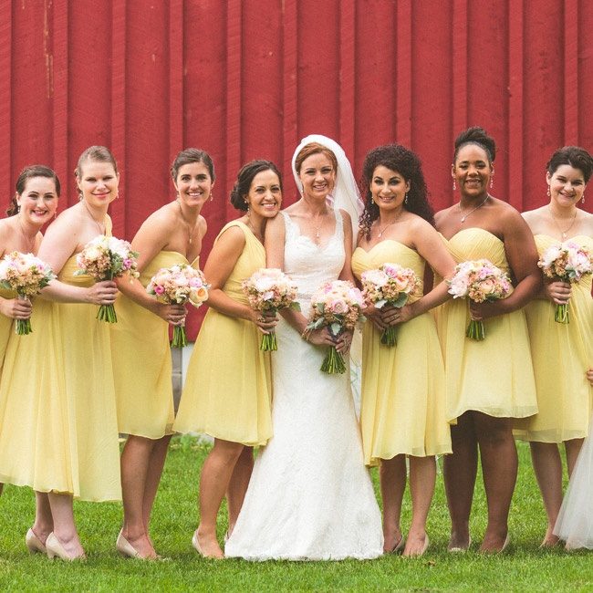 The bridesmaids wore dresses in different styles but in the same light yellow color and fabric.