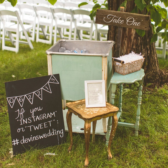 At the entrance to their ceremony, guests were offered water bottles and custom sunglasses. Jessica also created a chalkboard to display their wedding hashtag.