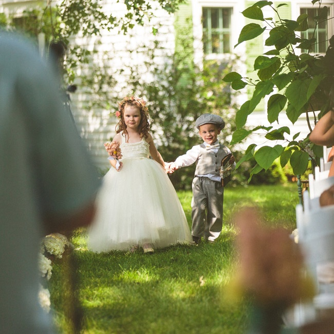 The groom's mother made the flower girl's tulle dress, and the ring bearer's suit, bow tie and newsboy hat were purchased on Etsy.