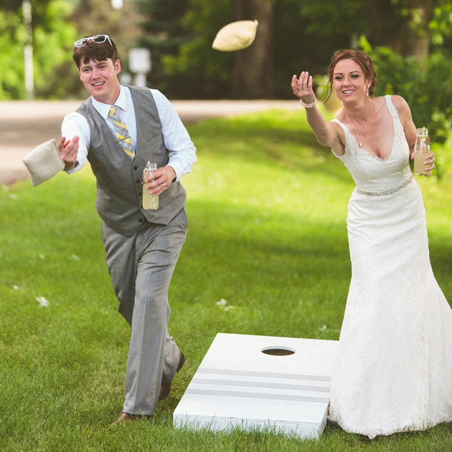 During cocktail hour, guests enjoyed games of bag toss and ladder golf (built by the groom's father) and sipped on the signature drink: lemonade with a hint of vanilla.