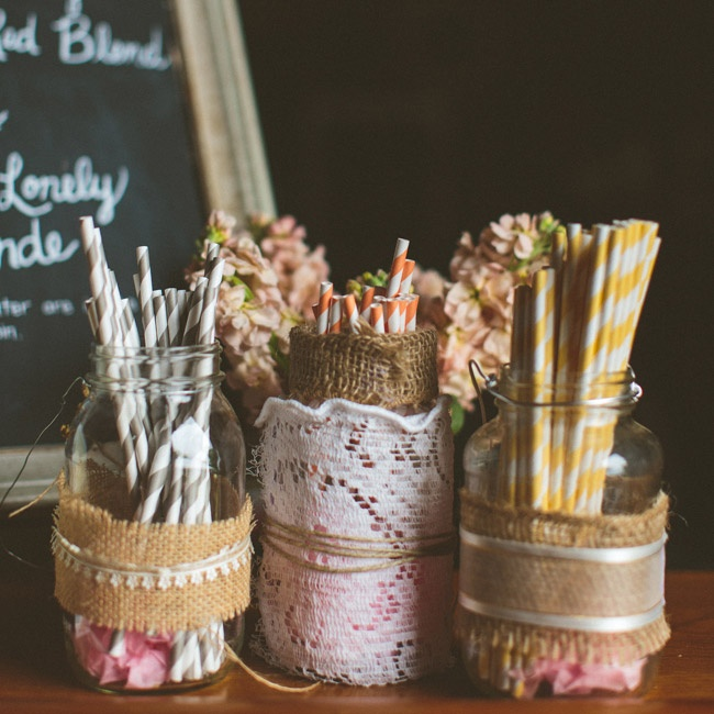 Gray, orange and yellow striped straws were set out in rustic, burlap- or lace-covered mason jars.
