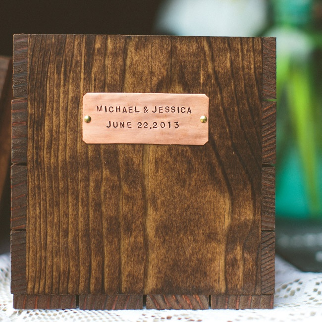 Michael and his father made several wooden boxes labeled with the couple's name and wedding date. The boxes were filled with hydrangeas and used as decor in the ceremony and reception.