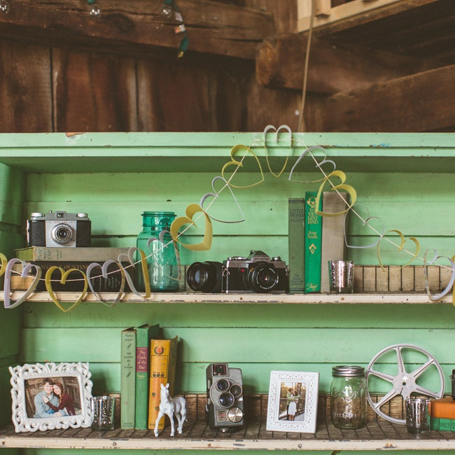 A collection of vintage cameras and books, as well as photos of the newlyweds—were on display as extra decor in the barn venue.