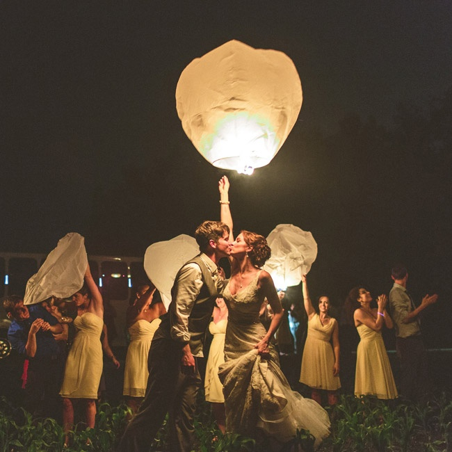 To end the night, a limo bus drove the newlyweds and the wedding party to a field to light and send off lanterns.