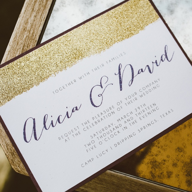 A stripe of bold gold glitter topped the simple invitations as a nod to the starry, sparkling theme.