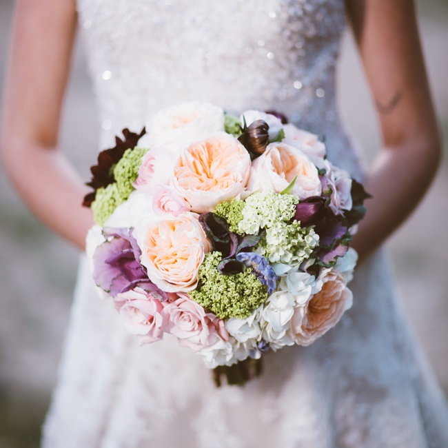 A bouquet with a mix of lush flowers in muted hues creates a vintage, romantic garden aesthetic.