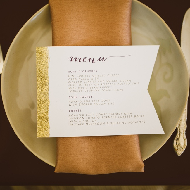 Neutral, gold-tinged chargers and napkins were topped with a sparkling menu card.