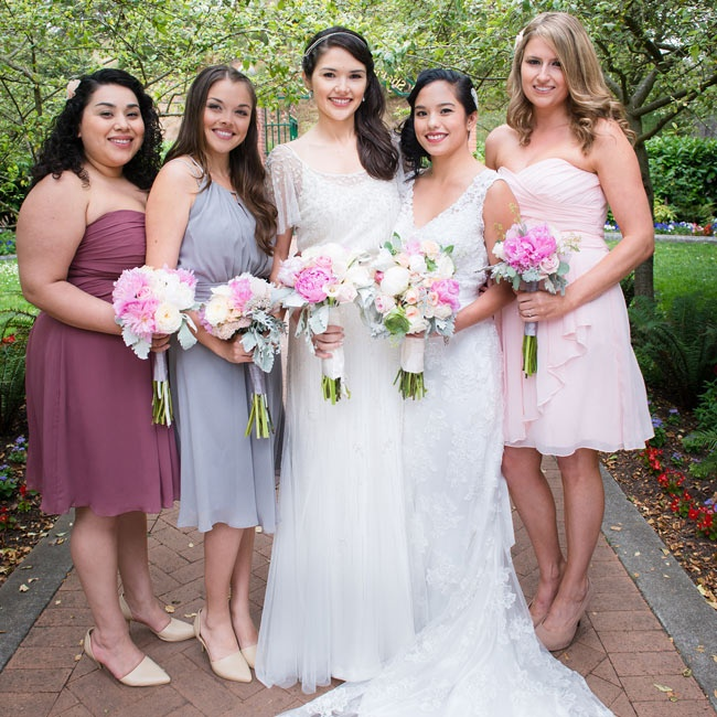 The bridesmaids selected short dresses in shades of pink and purple, which they wore with nude shoes and loose curls.