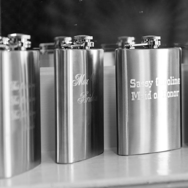 As gifts to their attendants, Alicia and Sarah gave them personalized flasks with their names and wedding title.