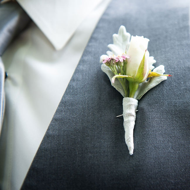 The male attendants wore sanity boutonnieres made of dusty miller, small roses and wildflowers.