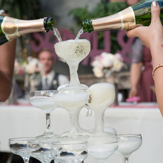 Wedding traditions carried into the reception, where Sarah and Alicia poured champagne over a tower of flutes.