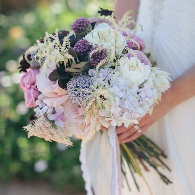 Deep purples, lilac, white and pink mixed together in the bride's bouquet.