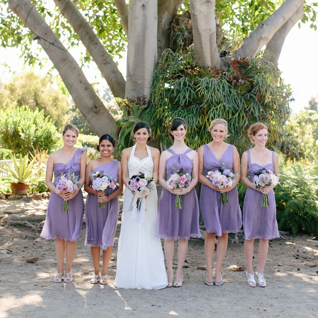 Megan's bridesmaids wore lavender-colored knee-length gowns with different necklines.