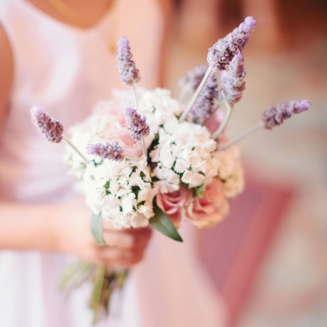 Hydrangeas and lavender mixed with roses in the flower girl's sweet bouquet.