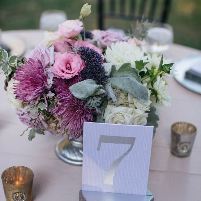 Silver table numbers upped the glam-factor on the reception tablescapes.