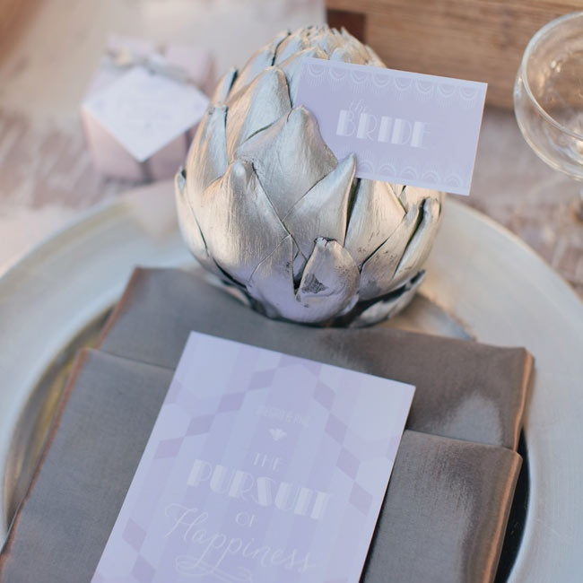 Holding the place cards at each seat was a painted silver artichoke, which added a unique and elegant element to the tables.