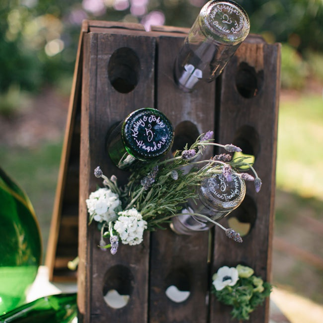 Empty wine bottles, flowers and rustic wooden details gave the reception decor a rustic edge.