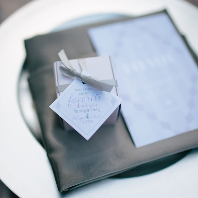 Slate linens made a perfect bed for the silver favor boxes laid on each place setting's charger.