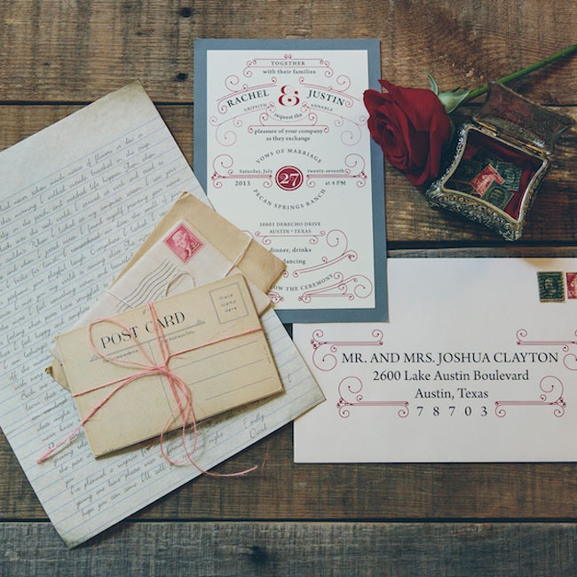 A muted blue and deep red invitation suite was inspired by a set of vintage postcards.