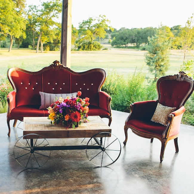 Antique lounge decor provided a lush, velvet seating area for guests.