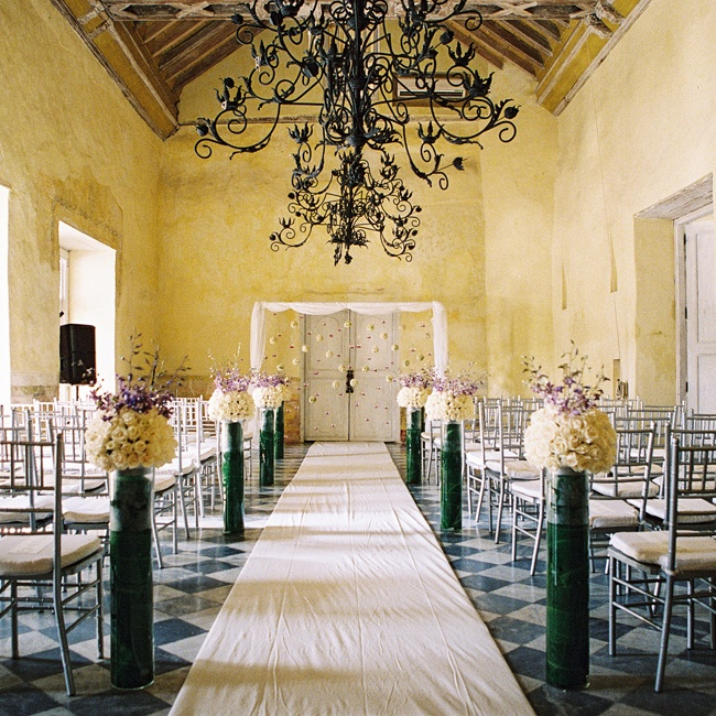 Casa Pombo, where the ceremony took place, is one of the oldest houses in Cartagena, dating back to the 1500s. Julie and Alvarez gathered with their family friends in the mansion's grand hall to exchange vows.