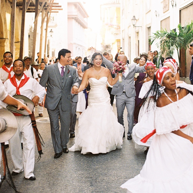"""We had a ""Gaita"" group, a traditional music ensemble in the Caribbean coast of Colombia, escort us from the ceremony to the reception. It was a dancing parade on the streets of the city, although truth be told, we did most of the dancing."" recalls Julie."
